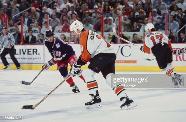 Dale Hawerchuk, Center for the Philadelphia Flyers in motion on the ice during Game 2 of the NHL Eastern Conference Finals against the New York...