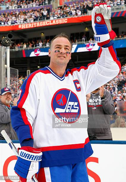 Dale Hawerchuk of the Winnipeg Jets alumni team acknowledges the crowd during team introductions for the 2016 Tim Hortons NHL Heritage Classic Alumni...