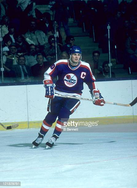 Dale Hawerchuk of the Winnipeg Jets skates on the ice during an NHL game against the New York Islanders circa 1988 at the Nassau Coliseum in...