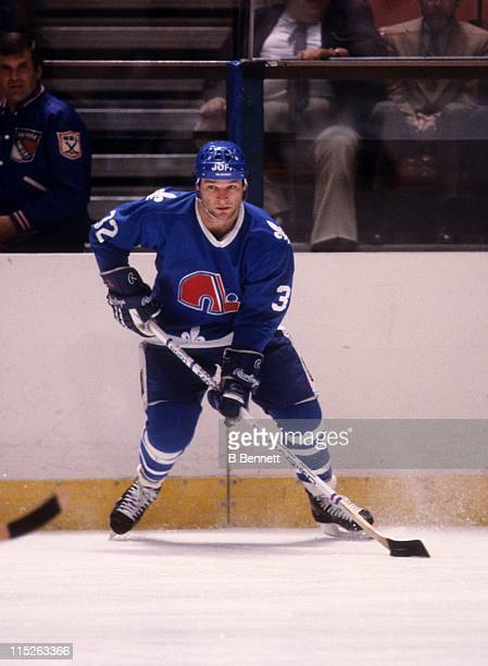 Dale Hunter of the Quebec Nordiques skates with the puck during an NHL game against the New York Rangers on November 25 1984 at the Madison Square...
