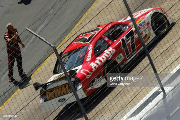 Dale Jarrett driver of the UPS Toyota motions at Matt Kenseth driver of the Arby's Ford during the NASCAR Nextel Cup Series Food City 500 at Bristol...