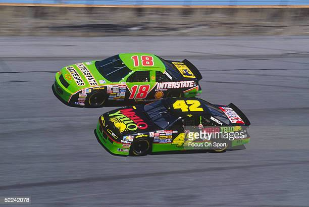 Dale Jarrett drives his Interstate Batteries car down a turn against Kyle Petty in his Mello Yello car during the Daytona 500 at the Daytona Speedway...