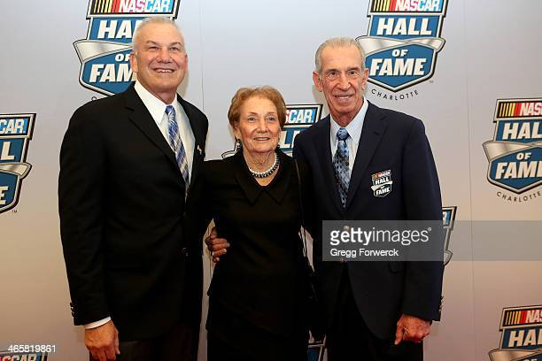 Dale Jarrett father Ned Jarrett and mother Martha Jarrett pose on the red carpet at NASCAR Hall of Fame on January 29 2014 in Charlotte North Carolina