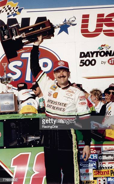 Dale Jarrett hoists the trophy symbolizing his victory in the 1993 Daytona 500 Jarretts win was his first of three career Daytona 500 wins