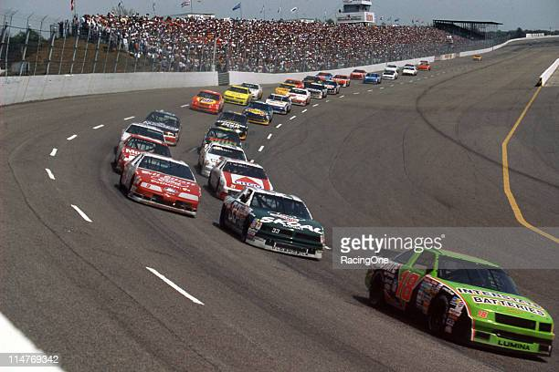 Dale Jarrett leads Harry Gant Bill Elliott and Morgan Shepherd during a NASCAR Cup race at Darlington Raceway