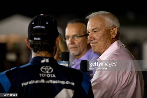 Dale Jarrett NBCSN tv host listens to Martin Truex Jr driver of the AutoOwners Insurance Toyota on set after the Monster Energy NASCAR Cup Series...
