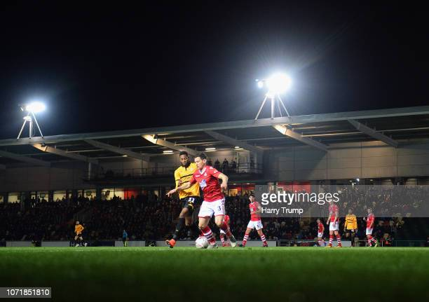 Dale Jennings of Wrexham chalenges for the ball with Jamille Matt of Newport County during The Emirates FA Cup Second Round Replay match between...