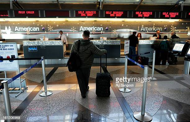 Dale Kely center waits to check in Tuesday Nov 29 for his flight to Chicago on American Airlines at Denver International Airport American Airlines...