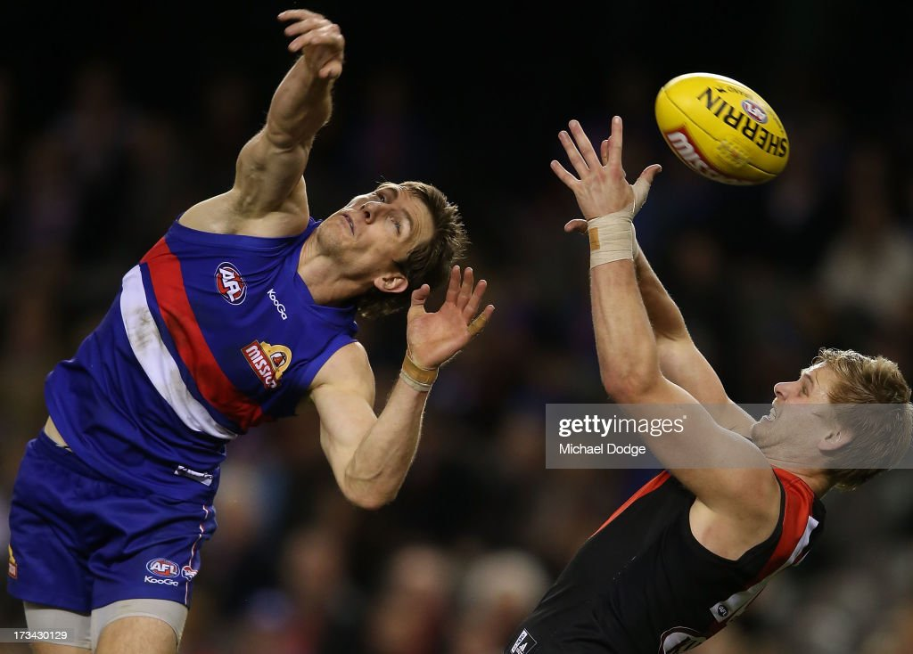 Dale Morris (L) of the Bulldogs contests for against Michael Hurley of the Bombers during the round 16 AFL match between the Western Bulldogs and the Essendon Bombers at Etihad Stadium on July 14, 2013 in Melbourne, Australia.