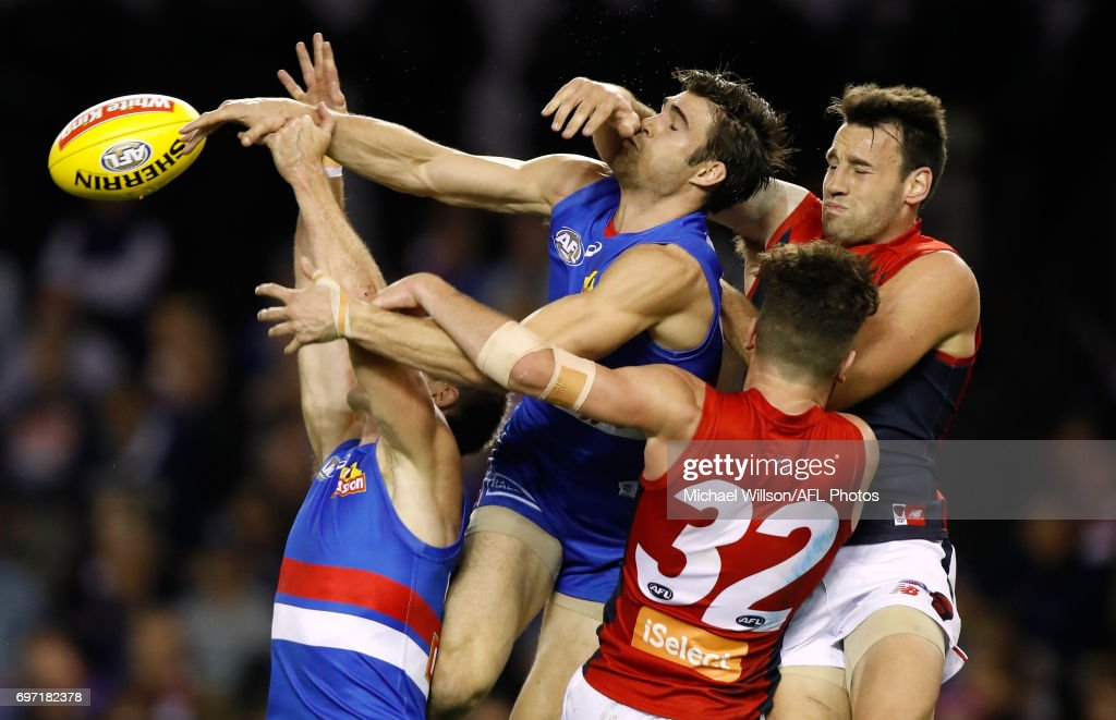 Dale Morris of the Bulldogs, Easton Wood of the Bulldogs, Tomas Bugg of the Demons and Cameron Pedersen of the Demons compete for the ball during the 2017 AFL round 13 match between the Western Bulldogs and the Melbourne Demons at Etihad Stadium on June 18, 2017 in Melbourne, Australia.
