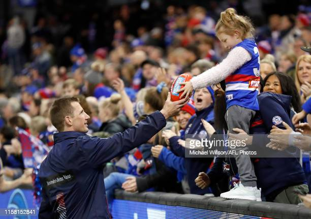 Dale Morris of the Bulldogs greets a young fan during the 2019 AFL round 19 match between the Western Bulldogs and the Fremantle Dockers at Marvel...