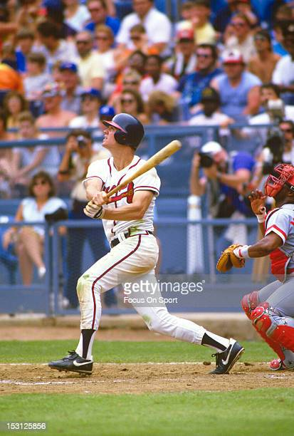 Dale Murphy of the Atlanta Braves bats against the Cincinnati Reds during a spring training Major League Baseball game circa 1987 Murphy played for...