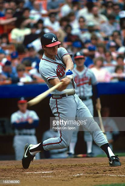 Dale Murphy of the Atlanta Braves bats against the New York Mets during an Major League Baseball game circa 1987 at Shea Stadium in the Queens...
