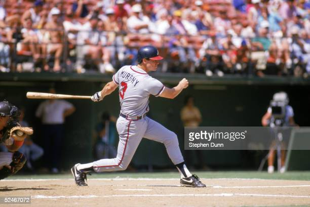Dale Murphy of the Atlanta Braves swings a misses for a strike during a game against the San Diego Padres in 1987 at Jack Murphy Stadium in San Diego...