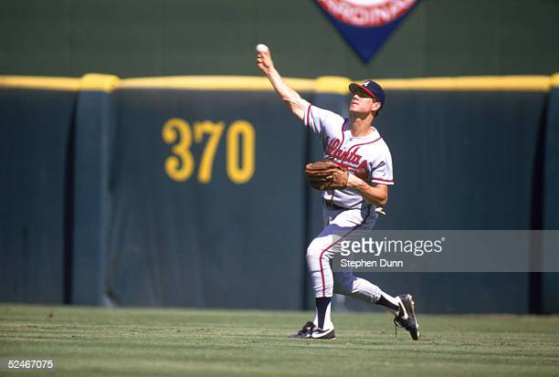 Dale Murphy of the Atlanta Braves throws the ball to the infield during a game against the San Diego Padres in 1987 at Jack Murphy Stadium in San...