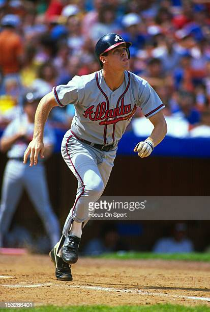 Dale Murphy of the Atlanta Braves watches the flight of his ball as he runs towards first base against the New York Mets during an Major League...