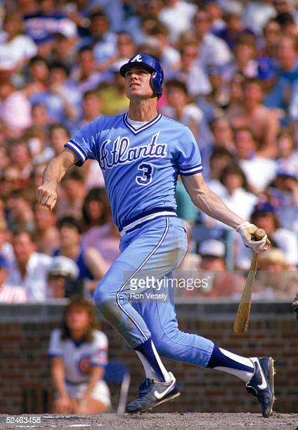 Dale Murphy of the Atlanta Braves watches the flight of the ball as he follows through on his swing during a game against the Chicago Cubs in 1986 at...