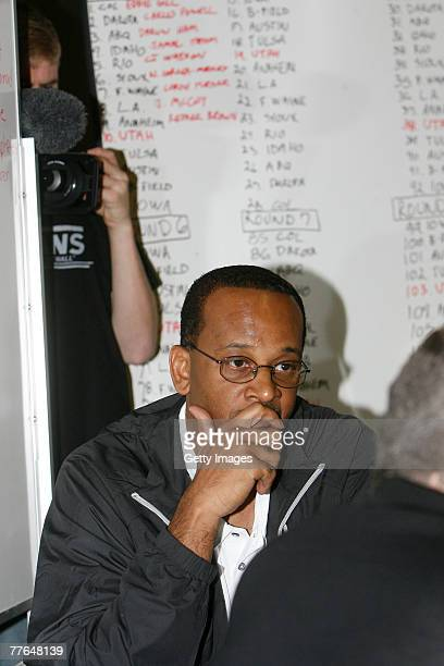 Dale Osbourne, Assistant Coach of the Utah Flash basketball team listens to others at the war room table during the Utah Flash D-Leauge draft at...