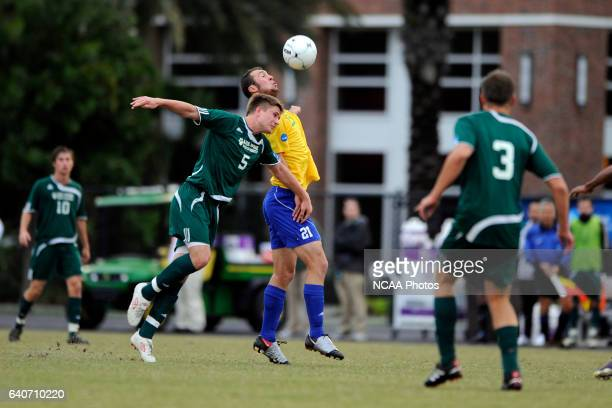 Dale Parker of LeesMcRae and David Barden of Fort Lewis battle for the ball during the Division II Men's Soccer Championship held at Pepin Stadium on...