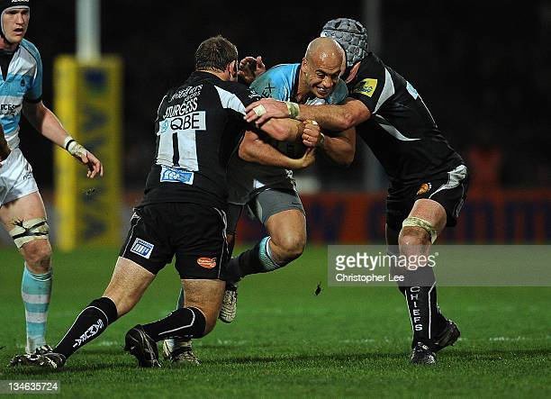 Dale Rasmussen of Worcester is stopped by Brett Sturgess and Richard Baxter of Exeter during the AVIVA Premiership match between match between Exeter...