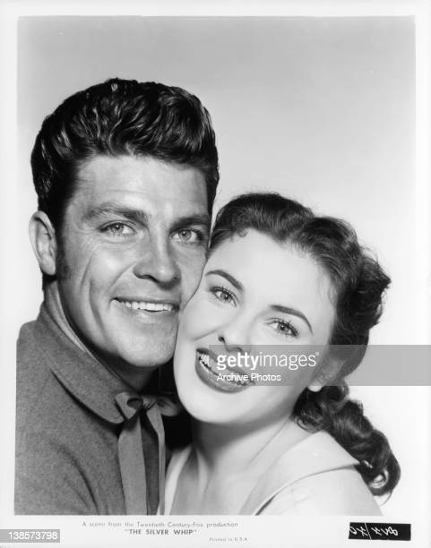 Dale Robertson and Kathleen Crowley embrace in a scene from the film 'The Silver Whip' 1953