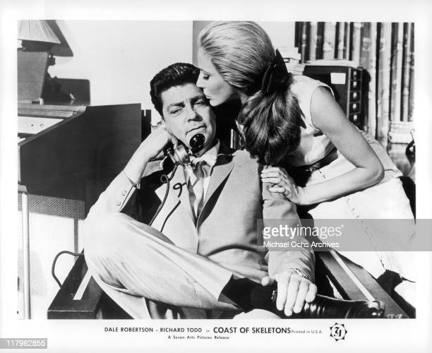 Dale Robertson is kissed by Elga Andersen in a scene from the film 'Coast of Skeletons' 1964