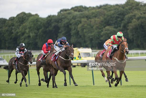 Dale Smith riding Raven Banner during The ApolloBET Home Of Cashback Offers Handicap at Haydock Park Racecourse on August 4, 2016 in Haydock, England.