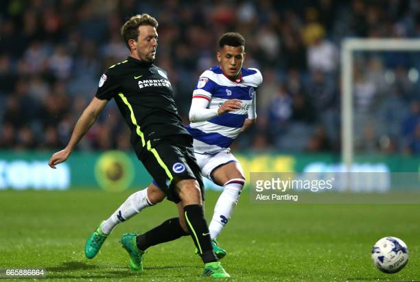 Dale Stephens of Brighton and Hove Albion and Ravel Morrison of QPR in action during the Sky Bet Championship match between Queens Park Rangers and...