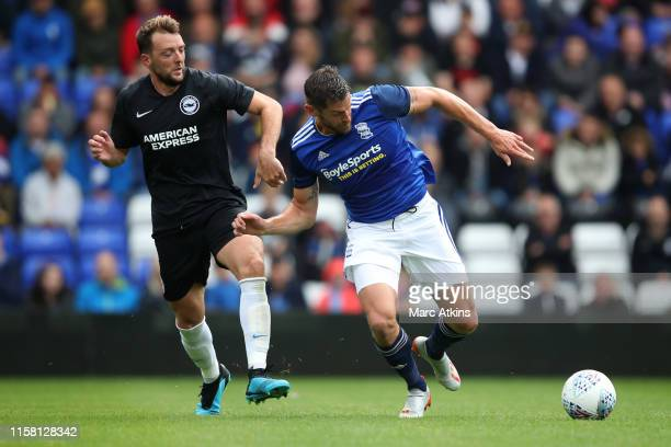Dale Stephens of Brighton and Hove Albion in action with Lukas Jutkiewicz of Birmingham City during the Pre-Season Friendly match between Birmingham...