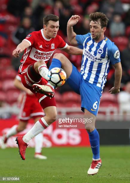 Dale Stephens of Brighton and Hove Albion is challenged by Jonny Howson of Middlesbrough during The Emirates FA Cup Fourth Round match between...