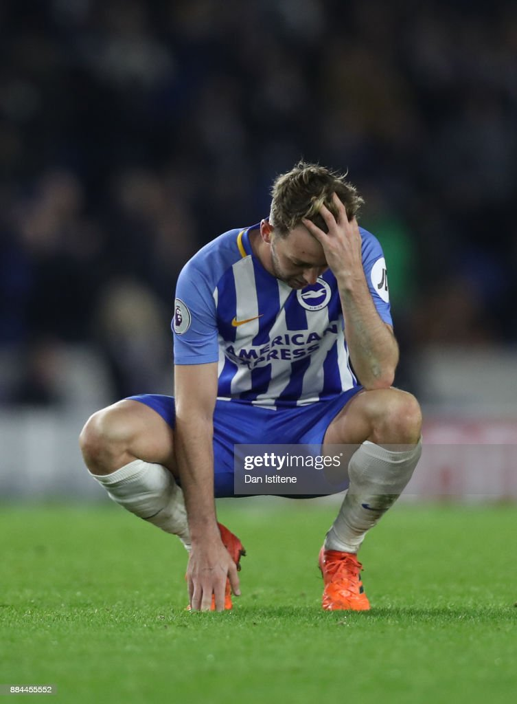 Dale Stephens of Brighton and Hove Albion look dejected after the Premier League match between Brighton and Hove Albion and Liverpool at Amex Stadium on December 2, 2017 in Brighton, England.