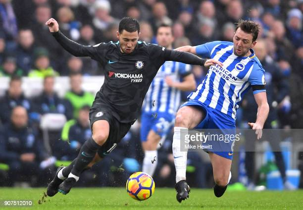 Dale Stephens of Brighton and Hove Albion tackles Eden Hazard of Chelsea during the Premier League match between Brighton and Hove Albion and Chelsea...