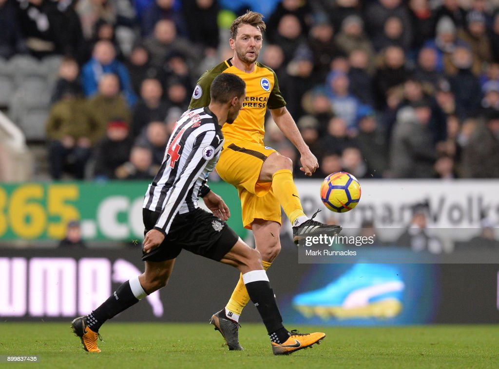 Dale Stephens of Brighton is takes on Issac Hayden of Newcastle during the Premier League match between Newcastle United and Brighton and Hove Albion at St. James Park on December 30, 2017 in Newcastle upon Tyne, England.