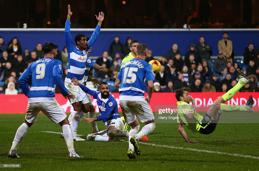 Dale Stephens of Brighton (R) scores his team's first goal during the Sky Bet Championship match between Queens Park Rangers and Brighton and Hove Albion at Loftus Road on December 15, 2015 in London, United Kingdom.
