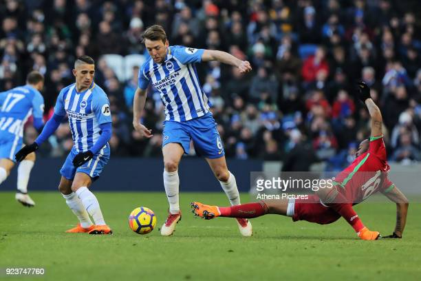 Dale Stephens of Brighton tackled by Jordan Ayew of Swansea City during the Premier League match between Brighton and Hove Albion and Swansea City...