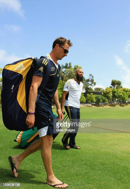 Dale Steyn and Hashim Amla arrive at the South African national cricket team nets session and press conference at Claremont Cricket Club on January...