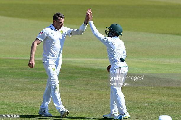 Dale Steyn and Temba Bavuma of the Proteas celebrate the wicket of Neil Wagner of New Zealand during day 3 of the 2nd Sunfoil International Test...