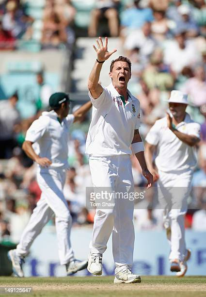 Dale Steyn of South Africa celebrates taking his fifth wicket by holding up 5 fingers after taking the wicket of Graeme Swann of England during day 5...