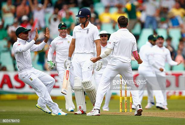 Dale Steyn of South Africa celebrates taking the wicket of Alastair Cook of England during day one of the 1st Test between South Africa and England...