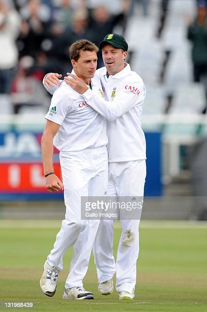 Dale Steyn of South Africa celebrates the wicket of Brad Haddin of Australia with AB de Villiers during day 1 of the 1st Sunfoil Series Test match...