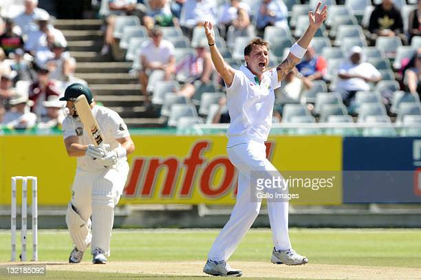 Dale Steyn of South Africa celebrates the wicket of Shane Watson of Australia during day 2 of the 1st Sunfoil Series Test match between South Africa...