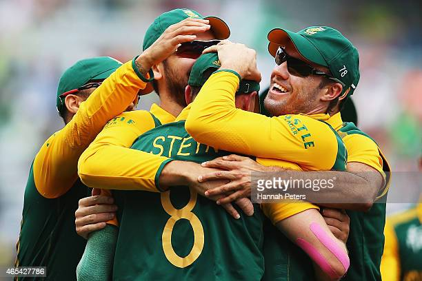 Dale Steyn of South Africa celebrates with AB de Villiers of South Africa and the team after taking a catch to dismiss Ahmad Shahzad of Pakistan...