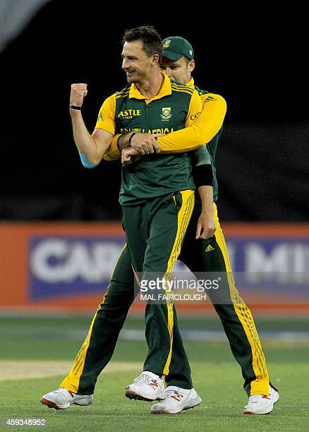 Dale Steyn of South Africa celebrates with David Miller after taking the wicket of Australia's Glenn Maxwell during the fourth oneday international...