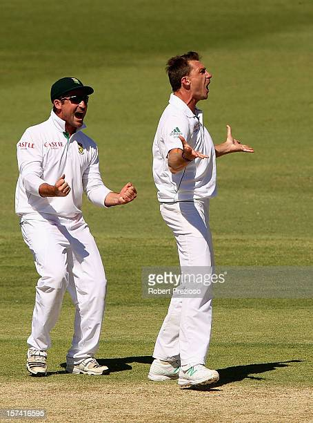 Dale Steyn of South Africa celebrates with Dean Elgar of South Africa the wicket of Michael Hussey of Australia during day four of the Third Test...