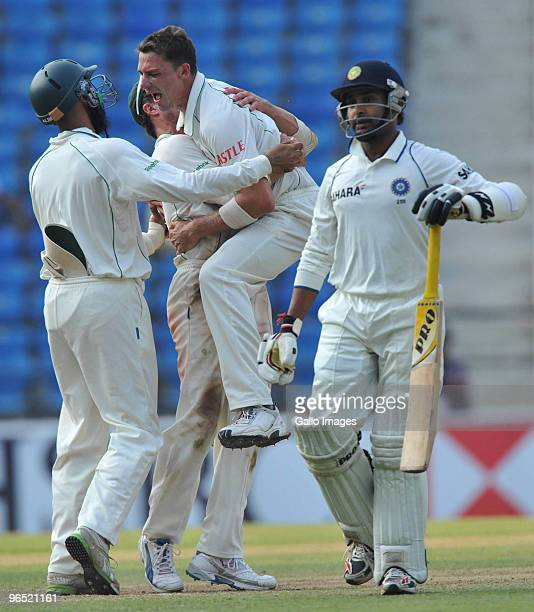 Dale Steyn of South Africa celebrates with teammates after taking his 10th wicket as South Africa wins by an innings and 6 runs during day 4 of the...