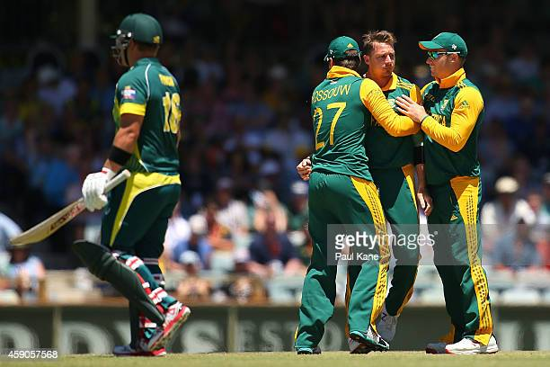 Dale Steyn of South Africa is congratulated by Rilee Rossouw and David Miller of South Africa after dismissing Aaron Finch of Australia during the...