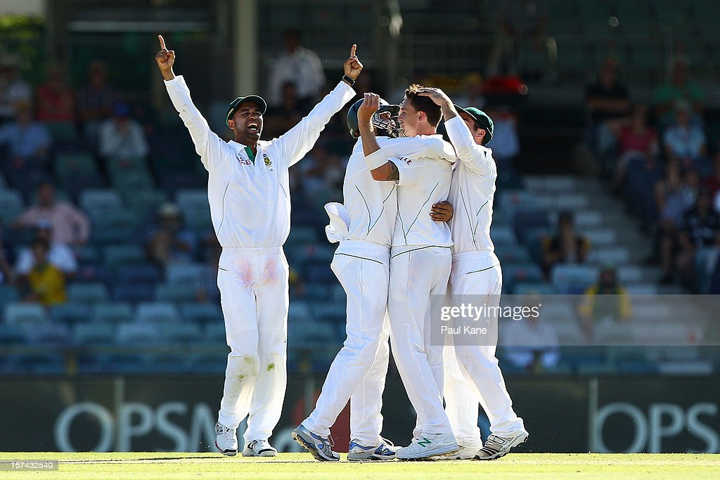 Dale Steyn of South Africa is congratulated by team mates after dismissing Nathan Lyon and winning the series during day four of the Third Test Match between Australia and South Africa at WACA on December 3, 2012 in Perth, Australia.