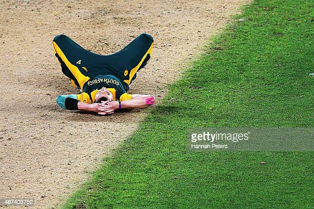 Dale Steyn of South Africa lies on the pitch after losing the 2015 Cricket World Cup Semi Final match between New Zealand and South Africa at Eden...