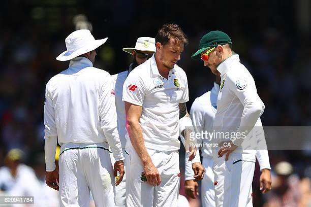 Dale Steyn of South Africa reacts after suffering a shoulder injury while bowling during day two of the First Test match between Australia and South...