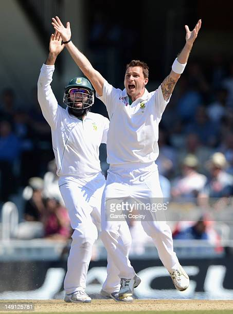 Dale Steyn of South Africa successfully appeals with Hashim Amla for the wicket of Stuart Broad of England during day five of the 1st Investec Test...